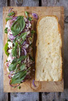 Basil, red onion, whole grain mustard, Parma ham, French baguette!! Yum!