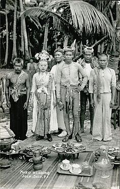 A Sulu Wedding ca1900.    A wedding of the son of a prominent datu at the village of Maibun, the capital of the Sulu Sultanate. The bride's traditional wedding makeup is of a pure white coconut mix.