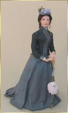 Beatrice is a fine lady from around 1890.    She wears a visiting costume, ready to go out. Just waiting for her husband to join her...