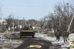 Fighters with separatist self-proclaimed Donetsk People's Republic army ride atop of a moving armoured personnel carrier in the village of Nikishine, south east of Debaltseve, February 17, 2015. REUTERS/Baz Ratner