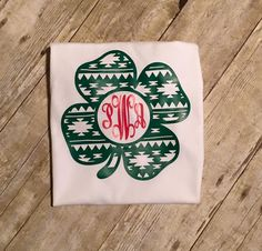 St. Patrick's Day Aztec Shamrock Monogram shirt. Can be done in regular green vinyl or glitter vinyl. Shamrock shirt available in 6 months and up and onesies in newborn to 24 months. The color of the                                                                                                                                                                                  More