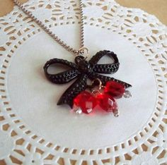 This little Bow Pendant DIY Necklace is an elegant accessory for the company holiday party.