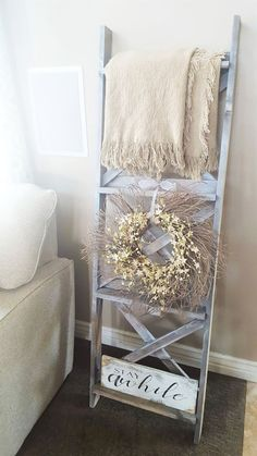 DIY blanket ladder or ladder shelf! Easy DIY home decor that has farmhouse style! The x slats on back and shelves add unique charm to a once simple ladder. Quilt Ladder, Diy Blanket Ladder, Home Living Room, Living Room Decor, Bedroom Decor, Nursery Decor, Farmhouse Blankets, Farmhouse Decor, Farmhouse Ideas