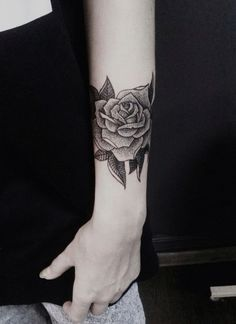 Black and gray dotwork rose forearm tattoo