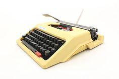 Vintage Typewriter Manual, Yellow typewriter Robotron DDR 70s, Traveller Typewriter, Office Decor, Portable Working Typewriter with black cover  Manual typewriter from the 70s made in East Germany. Its in good working condition and has beautiful light yellow color and German keyboard. Types nicely in black and red. This typewriter comes with a hard plastic black case and very usefull on journey or everyday. It will be perfectly decor in home or great vintage collectible item.  size…