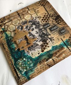 Altered children's board book, covered with old book pages. I stamped onto tissue paper and stuck down with 'slap it on'!