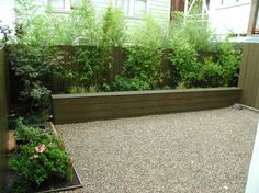 Here is another smaller sized yard utilizing a Trex seating wall and fence fronted with bamboo for screening mixed with perennials and small shrubs for variety.  The lawn has been replaced with gravel which is cheaper than pavers and decking and just as workable for a dining/entertaining area.