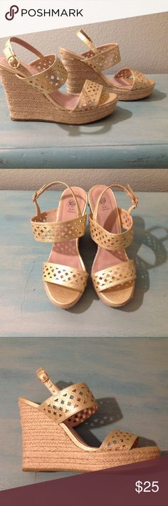 """G.C. Shoes """"Katie"""" Gold Wedge Sandals G.C. Shoes """"Katie"""" Gold Wedge Sandals. Gold synthetic leather straps with diamond cutouts and braided jute wrapped heel that is 4.75"""" with a 1.5"""" platform. Excellent condition, worn only two times. G.C. Shoes Shoes Wedges"""