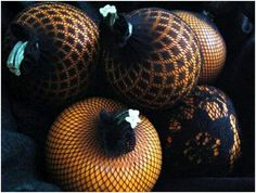Debbi and I found fishnet hose on sale at Pennys for 99 cents and each of us used one leg to decorate a pumpkin. It was easy and looks cute.