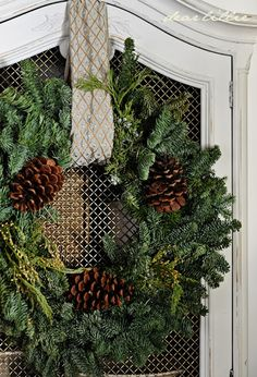 Wreath with pinecones and ribbon....2013 Christmas House Tour by Dear Lillie