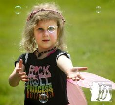 Mylie Fitzpatrick, 5, of Loganville chases bubbles at the May Day Fairie Festival at Spoutwood Farm.