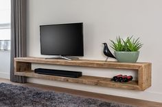 ROUGH in, Furniture Cabinet Edge of a Floating tv stand is made from old beams www. Raw Furniture, Living Room Furniture, Office Furniture, Living Room Tv, Home And Living, Tv Wanddekor, Tv Wall Cabinets, Rack Tv, Muebles Living