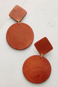 Geometrical Drops earrings from anthropologie - Nora Lozza has spent thirty years handcrafting pieces that celebrate artisanal leatherworking traditions passed down from generation to generation.
