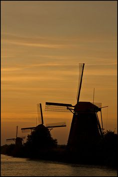 Mills at Sunset in Kinderdijk ~ South Holland, Netherlands Netherlands Windmills, Holland Windmills, Kingdom Of The Netherlands, Holland Netherlands, South Holland, Before Sunrise, Water Tower, North Sea, Le Moulin
