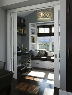 Gorgeous, sunny home office with a window seat for reading. And pocket doors! Love!