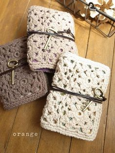 Crochet covered journals... or, take a lace doily, cut some cute paper to fit inside (cut to size, fold in half, and staple), tie on a leather string that is long enough to wrap around a couple of times, and tie a key or pendant on the other end
