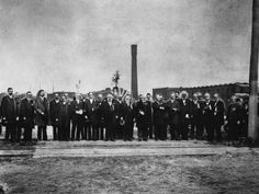 This image features both President Harrison and Frederick Douglass at Kodak Park. People in the photograph include Mayor Cornelius R. Parsons, Henry Hanford, Rochester Savings Bank4, Col. Henry A. Strong, President, Eastman Kodak Co.  President Harrison, W. Taft,  D.W. Powers, Roswell P. Flower, governor of New York state, Frederick Douglass, Hiram Edgerton, Gen. John A. Reynolds, Col. Jas. S. Graham