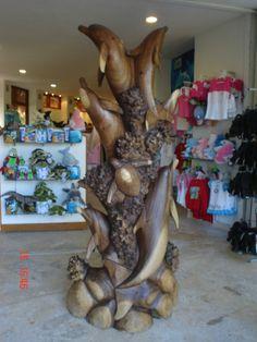 Hermosa escultura sobre Delfines.