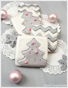 These cookies are too pretty to be real. Cool idea though - stamp cookie lightly with cookie cutter before baking; use as pattern for icing