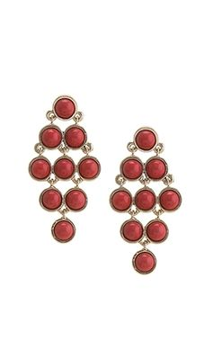 You'll be ready for your closeup in these Curtain Call earrings! These dotted drop earrings will have all eyes on you! The red stones will give you a unique look that will help you stand out. Find these statement earrings at Wild Lilies Jewelry! #redjewelry #statementearrings #summerstyle