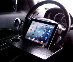 Hey, I found this really awesome Etsy listing at http://www.etsy.com/listing/151480826/car-steering-wheel-ipad-stand-table