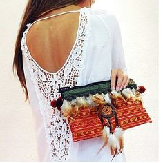 Boho chic ethnic tribal inspired clutch purse with modern hippie feather embellishments. For the BEST Bohemian fashion trends FOLLOW >>> http://www.pinterest.com/happygolicky/the-best-boho-chic-fashion-bohemian-jewelry-gypsy-/ <<< now.
