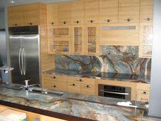 Louise Blue Granite countertops and backsplash. Incredible depth of colors.