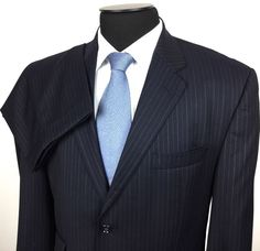 CALVIN KLEIN Men's 42L/W35 Navy Blue Pinstripe 2-Button Wool Suit~Flat Pants | Shop for men's sports coats, sports jackets, blazers, suits, shirts, pants and Ties at www.designerclothingfans.com Discover a variety of men's formalwear for the office to complete your wardrobe this Fall and Winter.