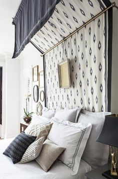 Use a thick patterned fabric to make a canopy that doubles as a headboard. | 14 DIY Canopies You Need To Make For Your Bedroom