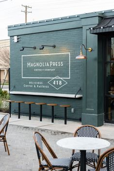 magnolia homes joanna gaines The cute corner coffee shop weve always dreamed about is officially open! Magnolia Press sits on the corner of and Webster, just a short wal Cafe Shop Design, Cafe Interior Design, Small Cafe Design, Deco Restaurant, Restaurant Design, Modern Restaurant, Bar Deco, Opening A Coffee Shop, Opening A Cafe