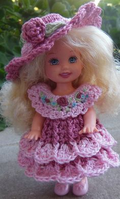 Mauve and pink dress done with size 10 thread with embroidery added to yoke. Crocheted by Shirley ☆ Crochet Doll Clothes, Doll Clothes Patterns, Crochet Dolls, Doll Patterns, Crochet Patterns, Barbie Kids, Barbie Dolls, Knit Or Crochet, Crochet Gifts