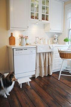 Small farmhouse style kitchen, IKEA single Domsjo sink, Lindingo white painted cabinets, reclaimed barn wood floors