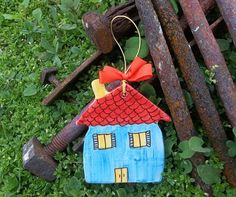 Blue ceramic little house with red roof by IoannasVeryCHic on Etsy, $15.00