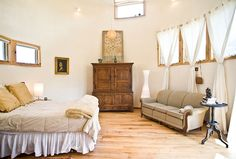 a very peaceful bedroom, converted from an old silo. Peaceful Bedroom, Dream Bedroom, Stained Dresser, Silo House, Grain Silo, Container Buildings, Alternative Style, Barn Homes, The Ranch