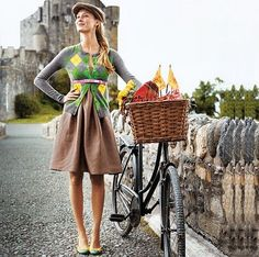 Love her outfit. Love her bike basket..heck I love it all! :)