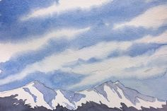Beautiful, step-by-step watercolor painting tutorial video demonstrating wispy cirrus clouds over a snowy mountain range.