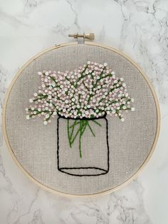 This is a beautiful hand made baby's breath bouquet in a mason jar embroidery. Its soft look made with French Knots makes for a perfect gift for a loved one, or for yourself! This one is made on a 6 inch embroidery hoop. It comes finished with backing. Hand Embroidery Patterns Flowers, Embroidery Hoop Crafts, Hand Embroidery Videos, Baby Embroidery, Simple Embroidery, Hand Embroidery Stitches, Hand Embroidery Designs, Cross Stitch Embroidery, Japanese Embroidery