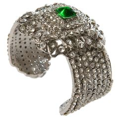 Fabulous vintage Chanel cuff .This rare diamante evening cuff with emerald poured glass center Chanel . 1990s