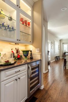 I really love a butlers pantry! I'd really love a butler too!! :)  Luxury Kitchen Remodel with white cabinets Greenwood Village