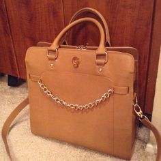 "Camel / Tan leather Gregory Sylvia Handbag Note: This is not a Michael Kors bag, but a similar style to one of his most well known bags. This Gregory Sylvia bag is in excellent condition! I love this bag but haven't used it in a while so I'm cleaning my closet out. It measures approximately 14""x13""x6"" and can be carried by the handles or using the shoulder strap. Very Michael Kors-esque with textured leather and gold hardware detail Michael Kors Bags"