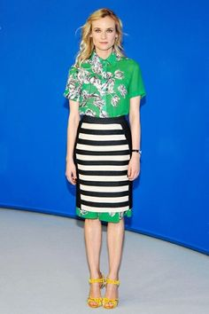 Watch of for the wonderful mixing of the pretty feminine green shirt with a harsher monotone slick pencil skirt.