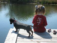 Isabel and her dachshund Sam fishin'.