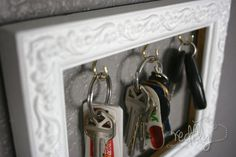 Picture Frame Key Organizer - 150 Dollar Store Organizing Ideas and Projects for the Entire Home
