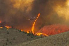 Amazing picture. Helicopter vs Fire-nado, Idaho style. (Beaver Creek Fire, Aug 2013)