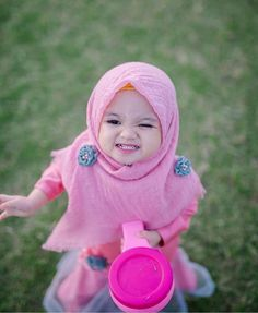 Image may contain: 1 person, outdoor Cute Little Girls, Cute Kids, Cute Babies, Baby Hijab, Kids Kiss, Cute Baby Girl Pictures, Baby Center, Children Images, Kids Outfits
