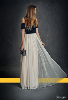 an, formal,and long, of shape short of the shoulders and along the waist down, colour black and withe, made in France, made of fabric,  for a party, is a dresse