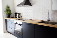 Black kitchen white french tiles