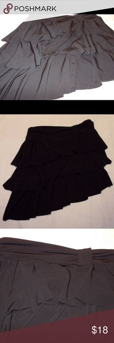 Black layered asymmetrical formal skirt Black formal asymmetrical formal skirt with 3 layers. No shorts under the skirt. Worn once in a cruise so the skirt has no flaws. THIS IS A CHILDREN'S LARGE 12/14! The long side is 17 1/4 inches long, the short side is 12 1/4 inches. Iz Byer Bottoms Formal