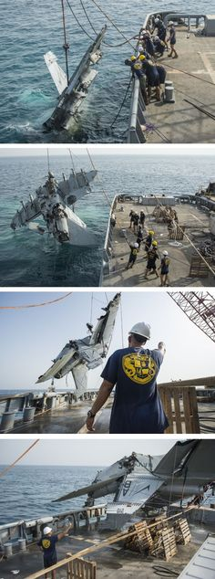 US Navy engineers recover the wreckage of a crashed F/A-18F Super Hornet.