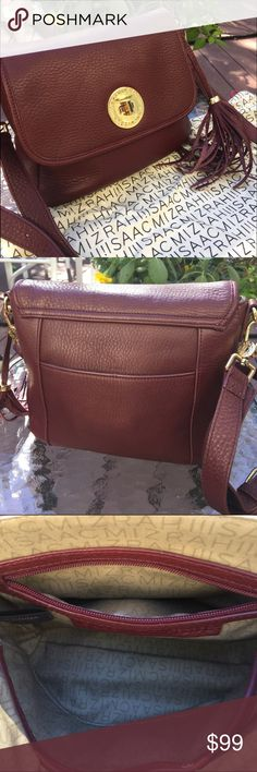 """Isaac Mizrahi Merlot Cross body [Authentic] This Isaac Mizrahi Merlot Cross body is in excellent condition. Has an adjustable leather shoulder strap. Comes with original fun leather tassel. Gold hardware and embellishments. The strap measures 18""""-22"""" long. Comes with dust cover.   Smoke free home ♡ Isaac Mizrahi Bags Crossbody Bags"""